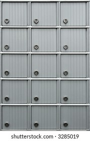 Rows of metallic mailboxes with numbers.