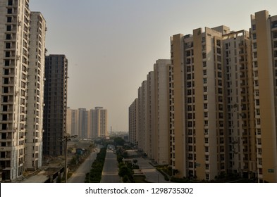 Rows of modern living society luxury society, high rise, multi story residential apartment building in Delhi NCR, Mumbai, Pune, Hyderabad, Lucknow, Jaipur, Kolkata, Noida, Gurgaon, Chennai, Bangalore
