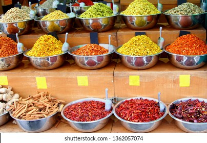Rows of modern metal bowls with  variety of colorful spices and herbs, grocery store, souk (Shuk) in Middle East