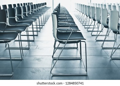 Rows of modern seats inside and empty conference hall