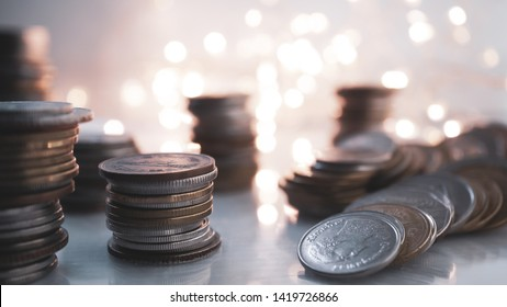 rows of money coins on light bokeh for finance , money , investment and business concept background