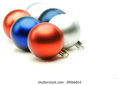 Rows of multi colored christmas balls on white background,closeup.