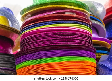 73daf6a0c9113 Rows of multi-colored straw panama hats for sale on shelves in a market  stall