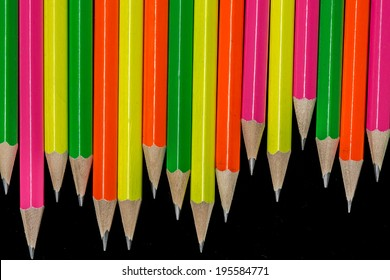rows of neon colored pencils