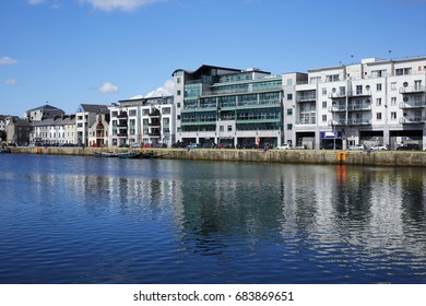 Rows of offices and housing on the shoreline of the regenerated docks of Galway