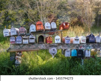 Rows of old colorful mailboxes in a rural setting
