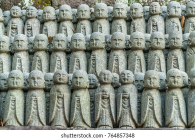 Rows of old Jizo Bodhisattva (Bosatsu) statues grouped near Jizo-do Hall at Haze-dera temple or Hase-kannon temple. Located in Kamakura, Kanagawa Prefecture, Japan