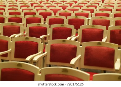 Rows of old red chairs in russian opera and ballet theater