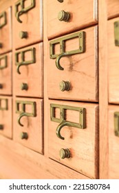 Rows of old wooden drawers