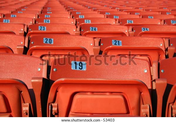 Rows of orange seating.