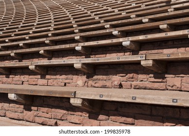 Rows of Outdoor Stone and Wood Stadium Seating