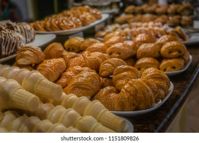 Rows of pastries and breakfast treats at a buffet bar.