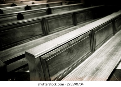 Rows of pews in a barcelona church.