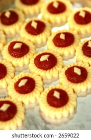 Rows of pineapple tarts waiting to be baked in the oven.