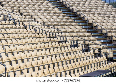 Rows of plastic chairs for spectators in the stands