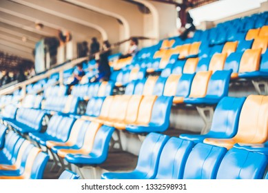 Rows of plastic seats on a grandstand, chair in a stadium, sitting area for spectator