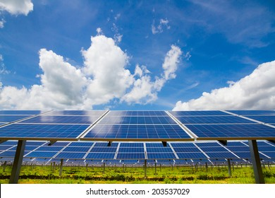 Rows of polycrystalline photovoltaic modules on the background of the cloudy sky