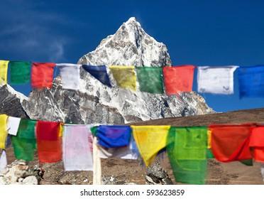 Rows of prayer flags and mount Arakam Tse sagarmatha national park, trek to Everest base camp - Nepal