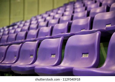 Rows of purple stadium seats with numbers.