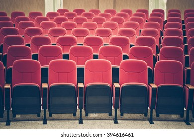 rows of red chairs in auditorium