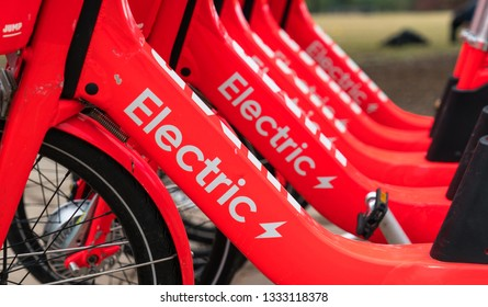 rows of Red Electric bicycle bike sharing ride sharing renewable and sustainable ride sharing bikes , renewable and sustainable mobile transportation