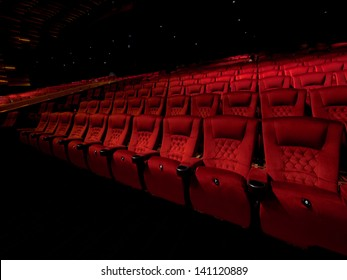 Rows of red movie theater seats in dark surrounding
