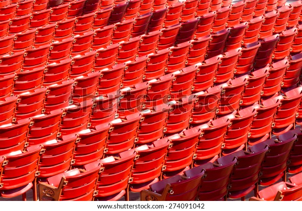 Rows of red seats at a stadium