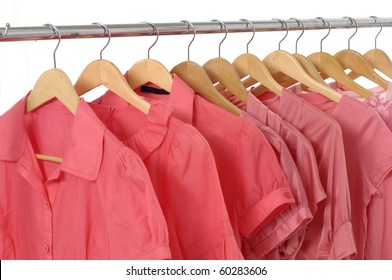 Rows of red t shirts on a clothesline