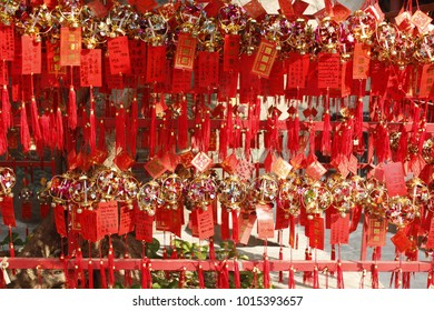 Rows of red wind bells in buddhist temple at A-Ma Temple, Macau