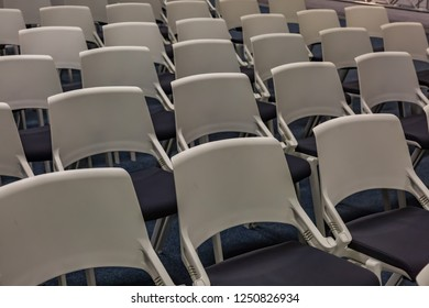 Rows of seats with chairs in a conference room