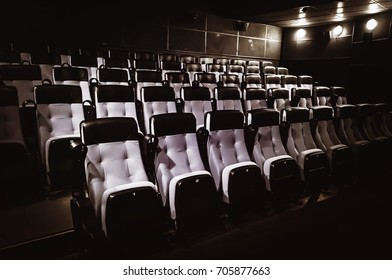 Rows of seats greyish blue color in a cinema theater.