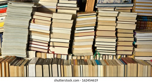 Rows of second hand books for sale at outdoor market