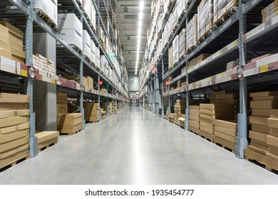Rows of shelves with boxes. Interior of warehouse.