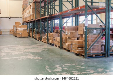 The rows of shelves with boxes in warehouse.