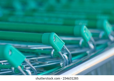 Rows of shopping carts at the entrance of supermarket