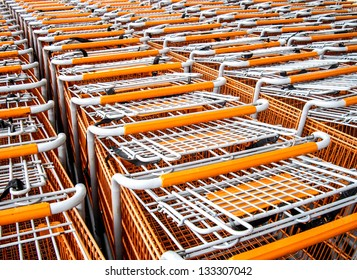 Rows of shopping carts parked outside a store.