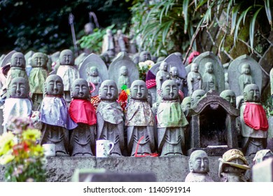 Rows of small Jizo monk statues with bibs - Japan. Jizo is a guardian of aborted children and kids who die prematurely.