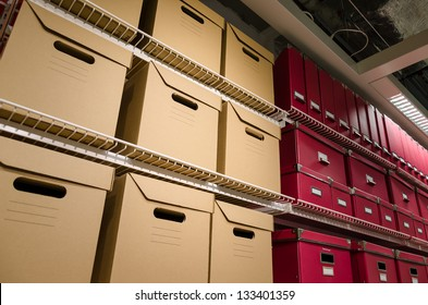 Rows of stacked storage boxes stacked on shelves