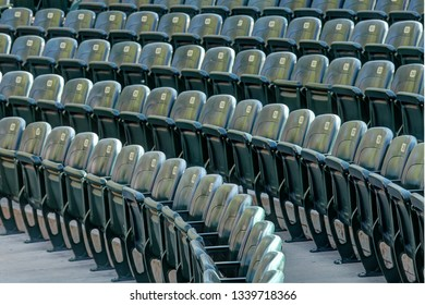 Rows of stadium seats at an outdoor stadium or arena.