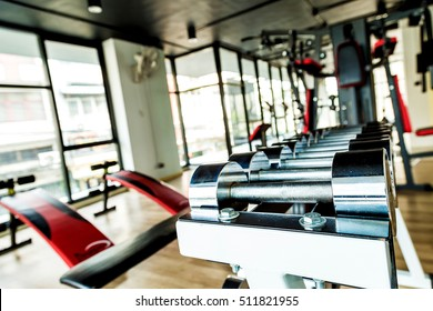Rows of stainless dumbbell in the gym, Sports dumbbells in modern sports club.