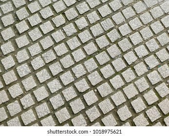 Rows of stone paving in pedestrian walk way