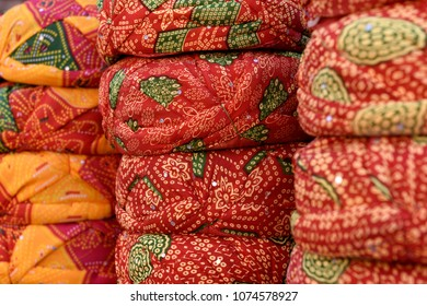 Rows of traditional Indian Rajasthani headwear, turbans or safa in Jaipur, Rajasthan / India.