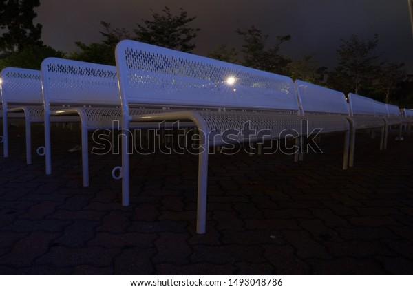 Swell Rows White Benches Outdoors Night Stock Photo Edit Now Alphanode Cool Chair Designs And Ideas Alphanodeonline