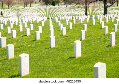 rows of white headstones at Arlington National Cemetery