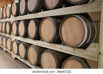 Rows of wine barrels stretching back to perspective