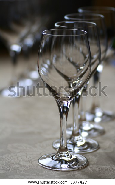 Rows of Wine Glasses on a Table