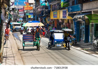 ROXAS CITY , PHILIPHINES-MARCH 17,  2016: City street view with local transport and people on March 17,2016. Roxas city on Panay island, Philiphines.  Transport and traffic jam in Philippines.