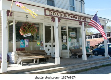 Roxbury, Vermont, USA - September 20, 2013: Several cars are parked outside the busy Roxbury Store on Main Street of this small Vermont town on a bright autumn day.