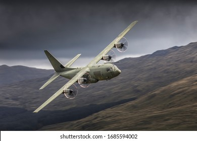 Royal Air Force C-130 Hercules transport aeroplane flying low level in the UK low fly system
