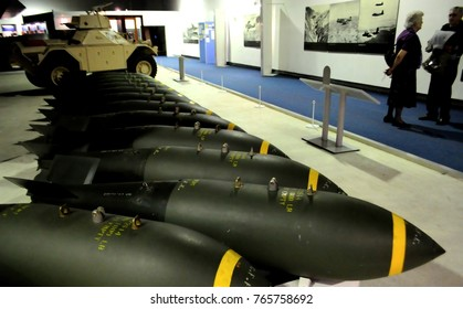 Royal Air Force Museum, London, UK. Daimler Ferret AFV in background - 10/27/15: Bombs displayed beneath Avro Vulcan in Bomber Hall.